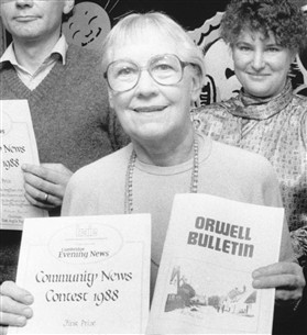 Photo:Peggy Miller in 1988 with winning prize for Orwell Bulletin
